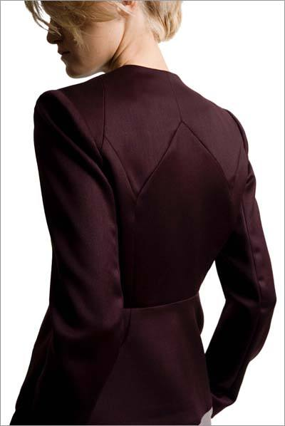 Back view with curved seams of burgundy wool suit jacket designed by Dara Ford.