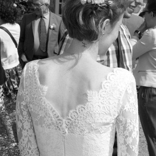 Upper back of lace wedding dress photographed in black and white