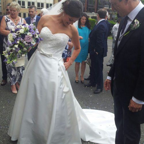 Bride wearing a Dara Ford strapless wedding dress with sweetheart neckline, lace bodice and full skirt
