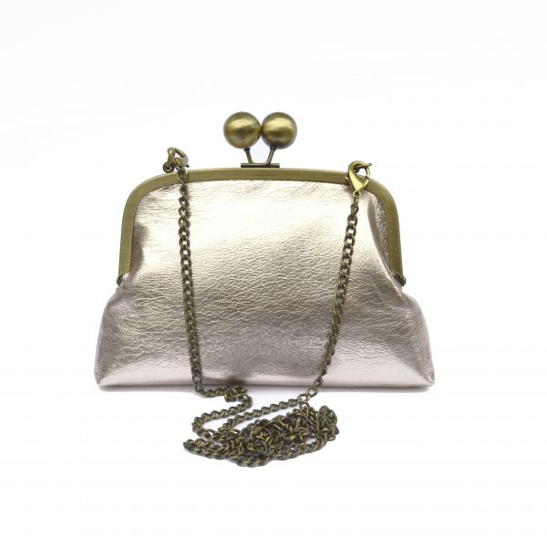 Front view of blush champagne foil clutch purse with chain strap.