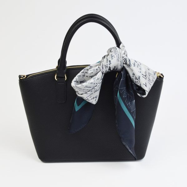 Silk scarf tied to bag handle in bow