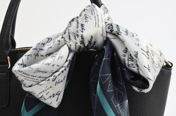 Detail of silk scarf tied in a bow