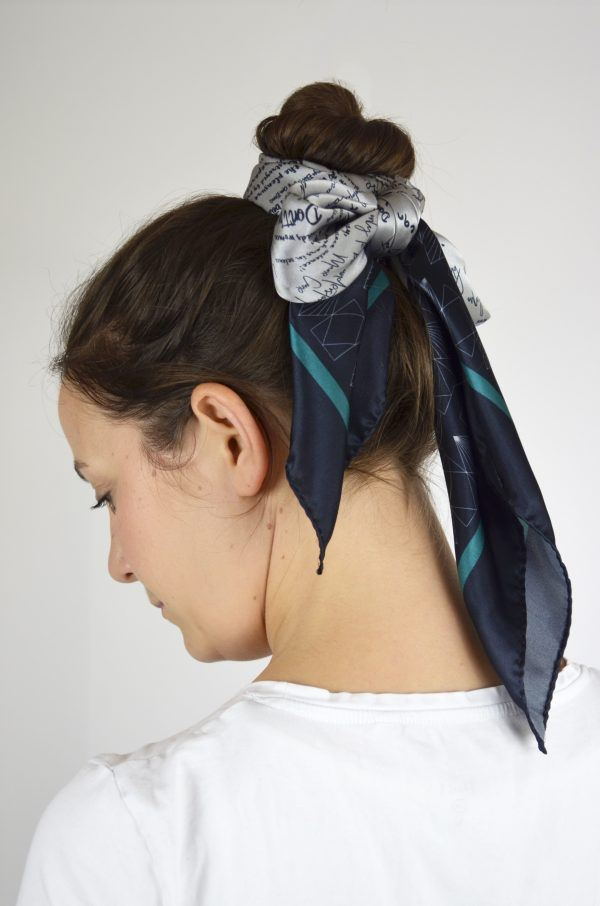 Model wearing silk scarf tied around her hair top knot