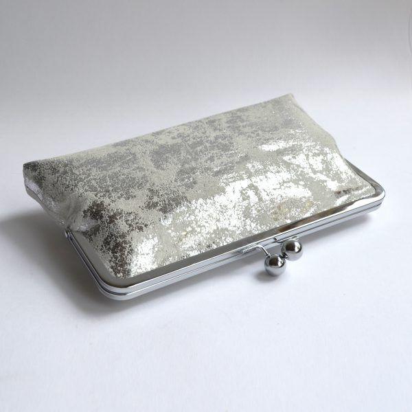 Birds eye view of silver clutch bag