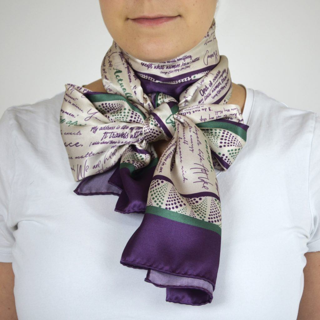 Silk scarf tied in large bow around neck