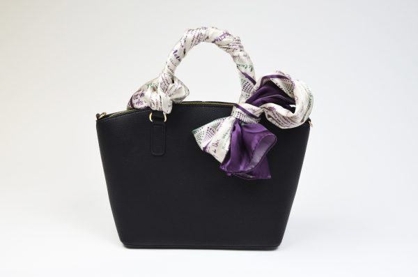 Silk scarf wrapped around bag handle