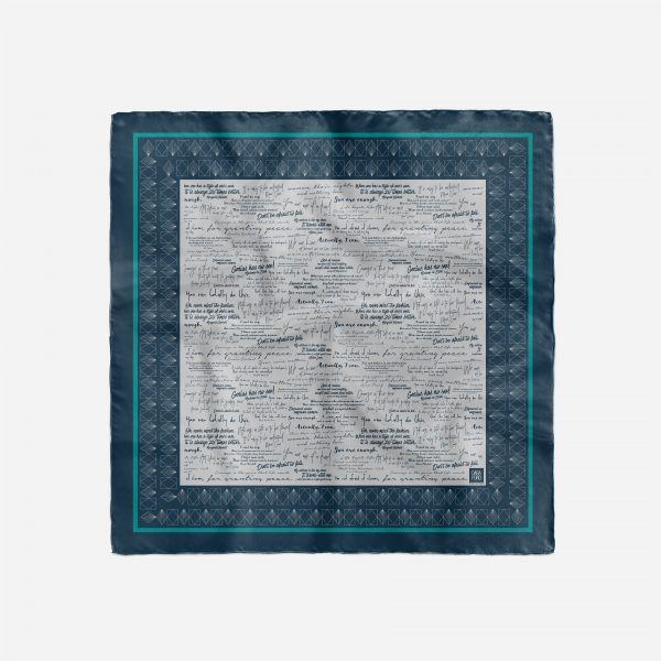 Full birds eye view of square silk scarf printed with inspiring quotes by women in history.