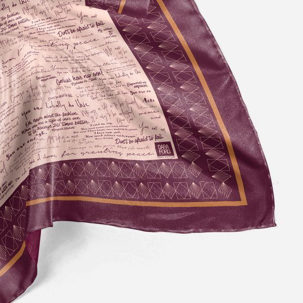 Square silk scarf. Burgundy printed quotes on pink background with mustard coloured border.