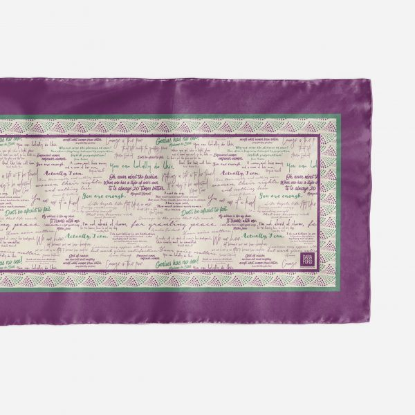 Close up of silk scarf with inspiring quotes by women in history in Suffragette colours